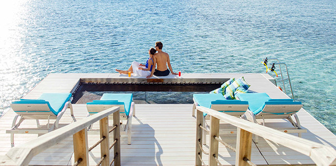 Couple at the Two Bedroom Overwater Pavilion